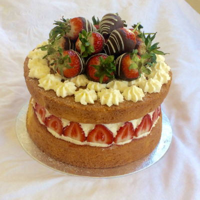 Victoria Sponge Victoria sponge with whipped cream, fresh strawberries and chocolate dipped strawberries