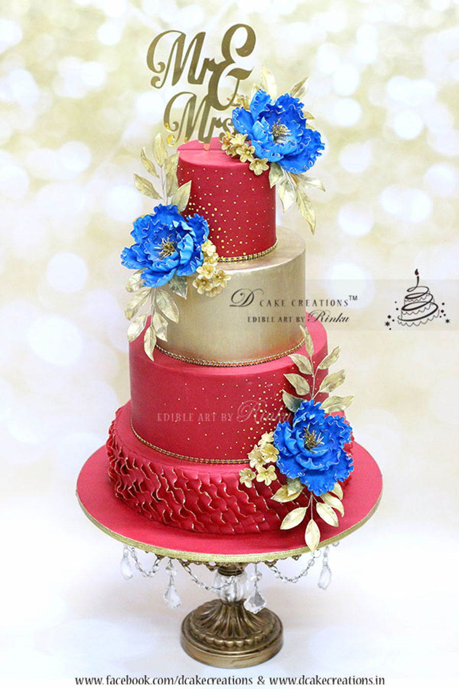 red amp gold wedding cake with royal blue flowers