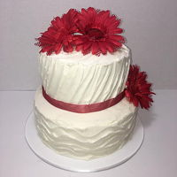 "2 Tiered Wedding Cake 2 Tiered Buttercream Wedding Cake with Silk Flowers and ribbon. Bottom tier is 8"", top tier is 6""."