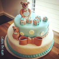 Baby Shower Teddy Bear Cake 2 layer vanilla cake with buttercream. Fondant covered with gum paste decorations.