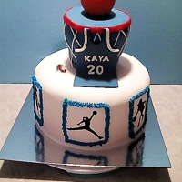 Basketball Themed Cake Red velvet cake with cream cheese frosting and fondant and modeling chocolate decorations