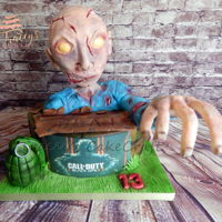Call Of Duty Zombie Cake Birthday cake for my son.Black Ops 3 zombie made from rkt and modelling chocolate, everything edible.