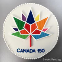 Canada 150 | Celebration Canada's 150Th Anniversary This is a large sugar cookie decorated with royal icing. The logo was piped as a RI transfer. The piped colours are the same shade as the...