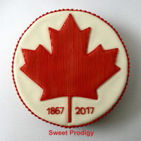 Canadian Maple Leaf Sugar cookie decorated with royal icing.