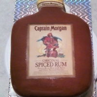 Captain Morgan Bottle red velvet with cream cheese frosting and modeling chocolate and edible images for decorations
