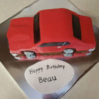 Car Cake This was my first attempt at a car cake; I made it for our mechanic. It's supposed to be a Chevelle. I'm not 100% happy with it...