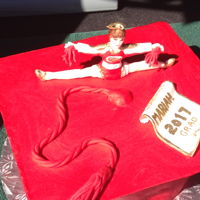 Cheerleader And Grad Hat Combo Cheerleader made out of gumpaste & dressed in the school colours. Grad hat covered in chocolate clay.