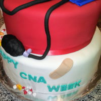 Cna Week Fun to make. Fondant blood pressure cuff, fondant gloves and pills.