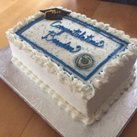 College Graduation Cake May 2017 1/2 sheet cake -vanilla cake with buttercream frosting - fondant cap with royal icing for tassel - sugar sheet of college.
