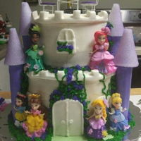 Disney Princess Castle Buttercream cake with all the princesses with Styrofoam fondant for pillars, not edible