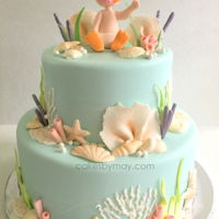 Diver Ocean Baby Shower Love all the subtle colors and details on this cake. Adorable little baby diver is upfront and center.