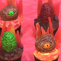 Dragon Fire Cupcakes Dragon eggs and heads made from chocolate and marshmallow fondant. The fire is made from hard candies. Inspired by one of my favorite shows...