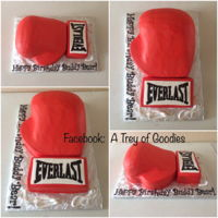 Everlast Boxing Glove Cake This is a 9x13 cake. Iced completely in buttercream icing. The Everlast and laces are made from Fondant.