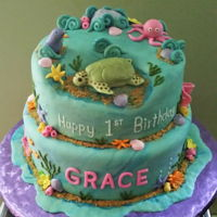 First Birthday Ocean Theme Cake 1st Birthday cake with sea turtle and ocean theme. Turtle is rice cereal treats and fondant.