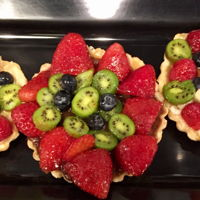Fruit Tarts I serve two sizes of fruit tarts an individual, party tart serves, 4-8 people I also have different shapes.