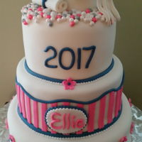Girly Graduation Cake High school graduation cake with a little bling for a young lady. Cap and diploma are fondant.