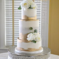 Gold And Gray Wedding Cake This classy wedding cake, is simple yet elegant. Two colors I never thought should be together look great!