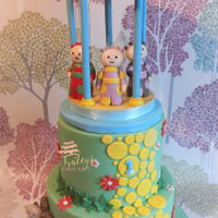 In The Night Garden Cake Dairy free cake, handmade edible figures. Topper was made from cake drum, dowels & dummy top covered with icing.