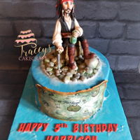 Jack Sparrow Cake Pirates of the Caribbean themed cake with handmade edible Jack Sparrow topper