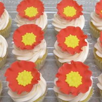 Jeweled Poppy Cupcakes orange fondant poppies, yellow jewel centers, Swiss meringue buttercream, white cupcakes