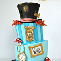 Mad Hatter Cake This birthday cake is inspired by the mad hatter! Made with fondant and modeling chocolate!