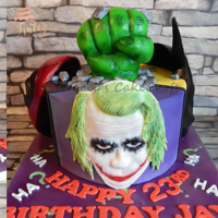 Marvel V's Dc Cake! Cake featuring The Joker, Batman, Deadpool and the Hulk.All handmade and edible