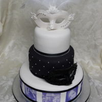 Mask Wedding Cake This is a Wedding Cake for a couple that wanted to incorporate masks on their cake. Gumpaste masks with real feathers. Edible images of the...