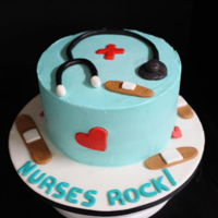 "Nurses Cake 8"" white almond cake with buttercream fondant accents"