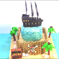 Pirate Island Cake A pirate and island themed cake. Topped with my pirate ship that I made. Decorated with fondant palm trees, skull and crossbones, pirate...