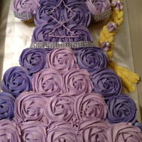 Rapunzel Cupcake Dress Cake Chocolate and vanilla cupcakes with buttercream frosting and fondant braid