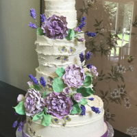 Rustic Wedding Cake Vanilla bean buttercream cake with gum paste lavender and English roses