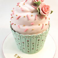 Shabby Chic Giant Cupcake shabby chic style for this sculpted giant cupcake with some sugar roses on top and hand painted details for the bottom.