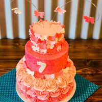 Shades Of Pink Glitzy, girly rosette and butterfly cake for a sweet 7th birthday