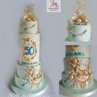 Shell Necklace Cake Shell Necklace Cake symbolizes the summer with the gorgeous shell of shells and golden friezes