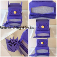 Shockwave Transformers Cake I made this cake for my son's birthday. This is ShockWave from the transformers. I iced him in buttercream and trimmed it in Fondant....