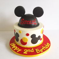 "Simple Mickey Cake 9"" diameter covered in buttercream w/ fondant accents top tier 6"" hemi cake covered in black fondant"