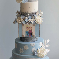 Snow Queen This cake stands at 30 inches tall and has approximately 125 sugar flowers/leaves.
