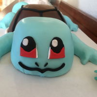 Squirtle Cake My first fondant covered and carved cake. I also tried out modeling with rice crispies. It was a white cake with guava buttercream that we...