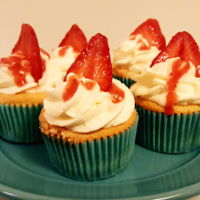 Strawberry Sponge Cupcakes Chiffon cupcakes with fresh whipped cream and macerated strawberries