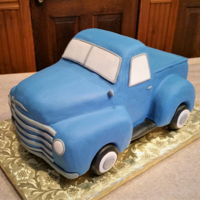 Vintage Chevy Truck Classic truck ordered by a grandaughter for 80th birthday. Wheels are rice cereal treats, everything else is cake.