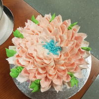 Watercolor Flower Water color cake with a big flower on top.
