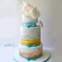 Watercolor Sunset Wedding Cake This cake was inspired by the sunsets of Arizona. The bride felt particularly connected to the sunsets and beautiful blues and wanted them...