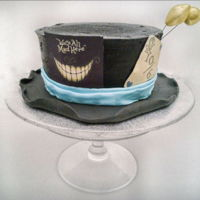 We're All A Little Mad Here Mad Hatter Cake. Bright red Velvet Cake covered in Black chocolate buttercream.
