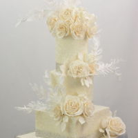 White Wedding Cake buttercream finish,sugar sparkle ,sugar flowers, wafer paper feathers