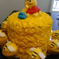 Winnie The Pooh Cake All buttercream rosettes with rice krispie topper covered in fondant.