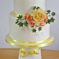 Yellow Rose Two tiers - fruit cake and vanilla - with gumpaste rose, buds, daisies and ivy.