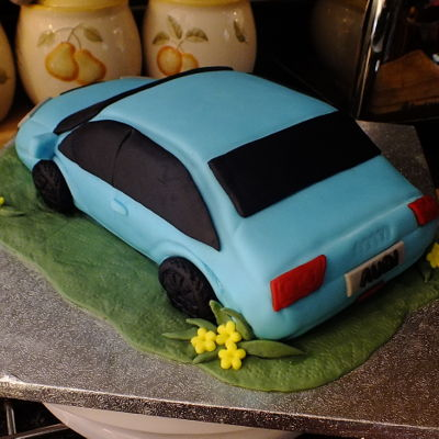 Audi Car Cake Red velvet with vanilla butter cream and made to look like an audi car.