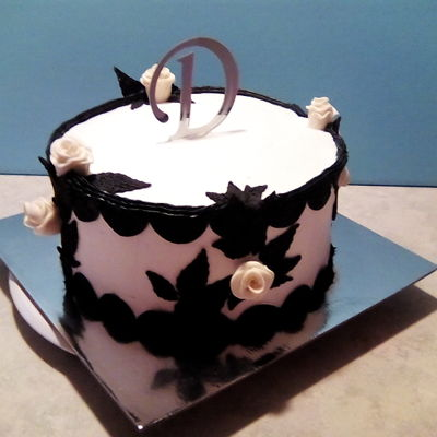Black And White Cake Champagne flavored cake with cream cheese buttercream and modeling chocolate decorations
