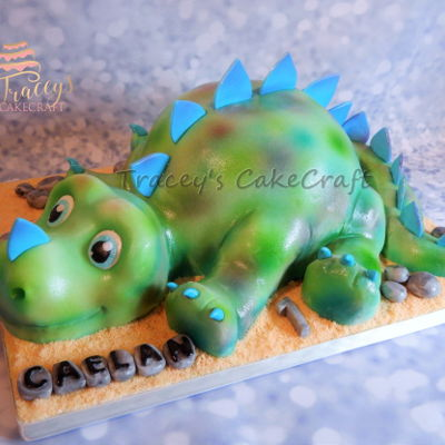 Cute Dinosaur Cake Baby dinosaur cake made for my grandsons first birthday. Rkt head, tail & legs. Gum paste spikes & claws.