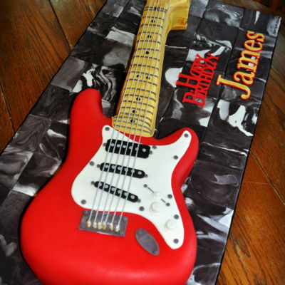Fender Electric Guitar Full size Fender Electric Guitar, a replica of the birthday gentleman's guitar, in rich chocolate cake with vanilla/almond buttercream...
